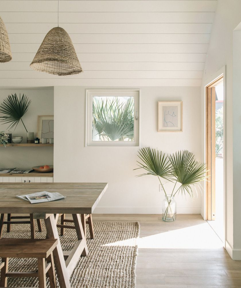 The entrance with  generous table and woven rug feels more like someone   dining room than hotel lobby also dreamy minimal interiors gordijnen minimalist home decor rh pinterest