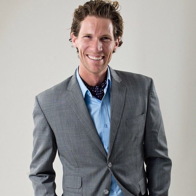 Our model looking happy in a Rex Light Grey suit. Available at www.suitopia.com