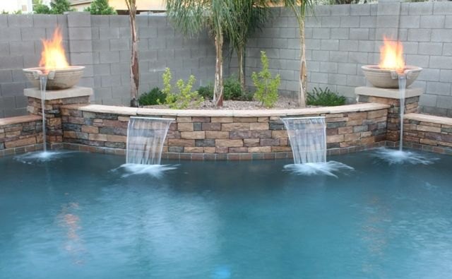 Fire Pots In Pools So Get Your Flame On And Check Out What Fun With Fire Can Look Like In Pool Remodel Backyard Pool Backyard Pool Landscaping
