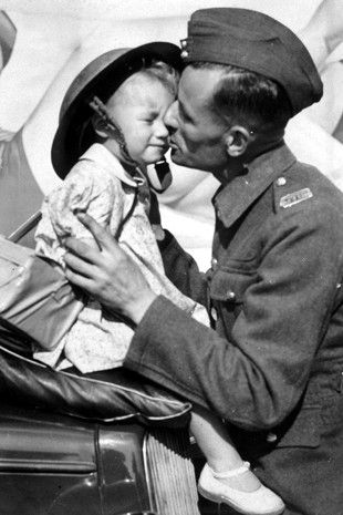 A farewell kiss -A soldier kissing his daughter goodbye before he leaves Britain.