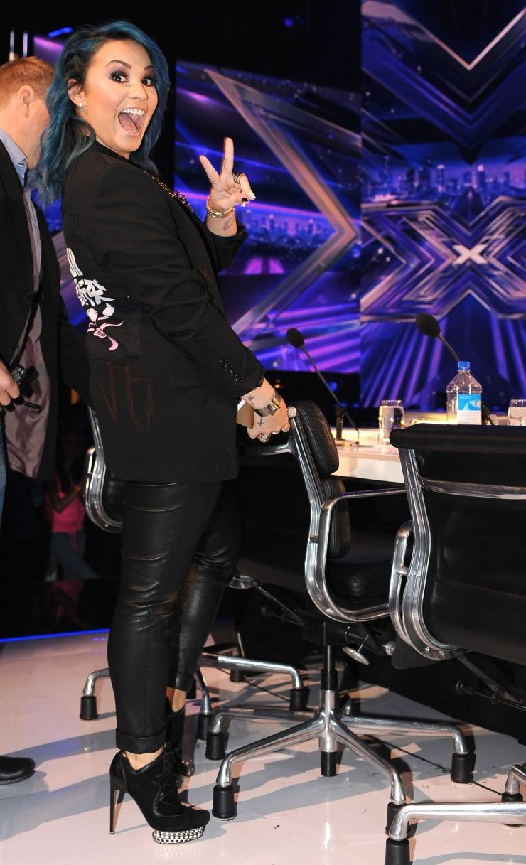 """Peace in the U.S.A. Demi Lovato shows some excitement during a taping of """"The X Factor"""" on Nov. 21 in Hollywood, Calif."""