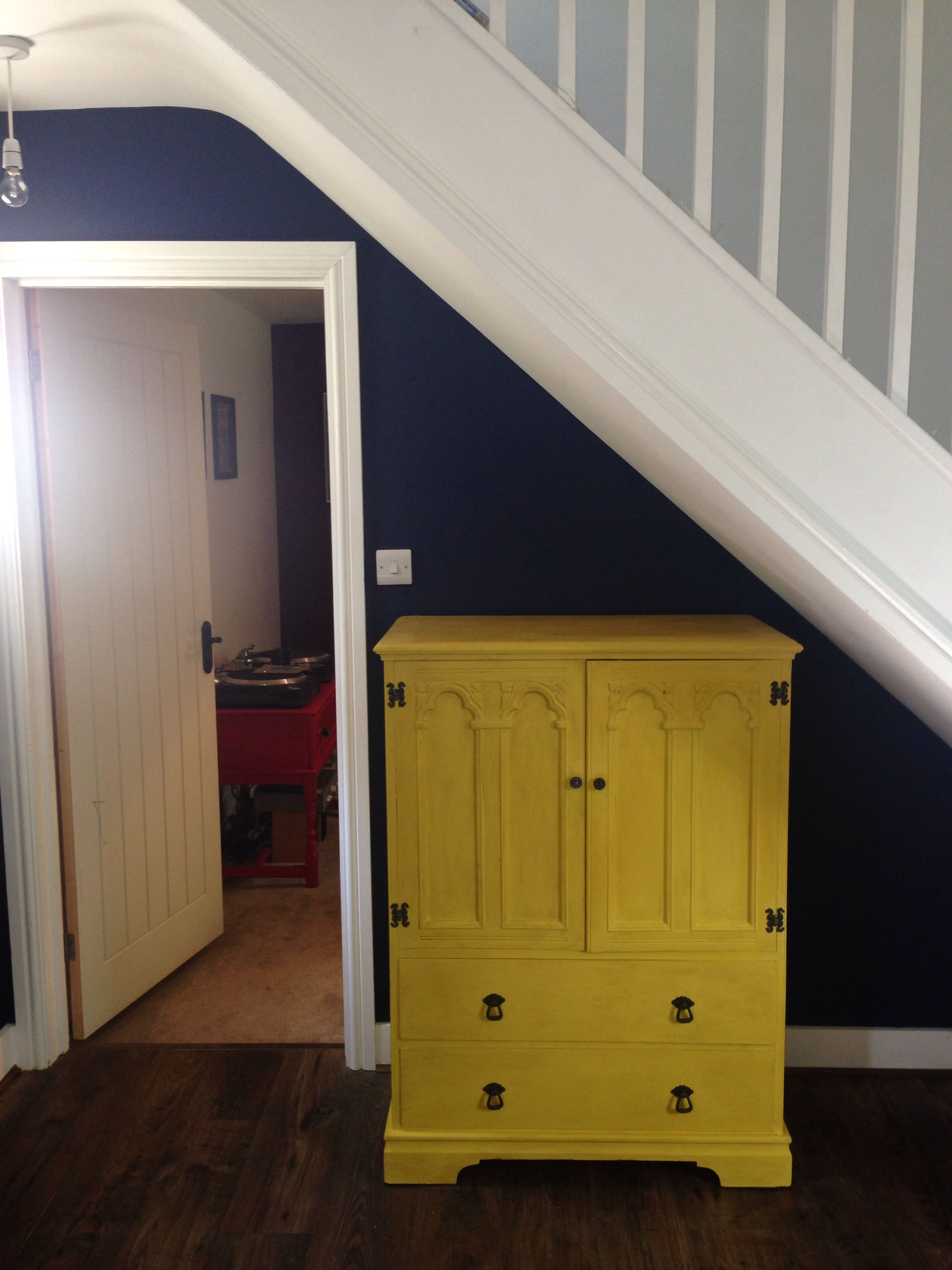 Bright pop of yellow against navy walls. Paint is Dulux Sapphire ...