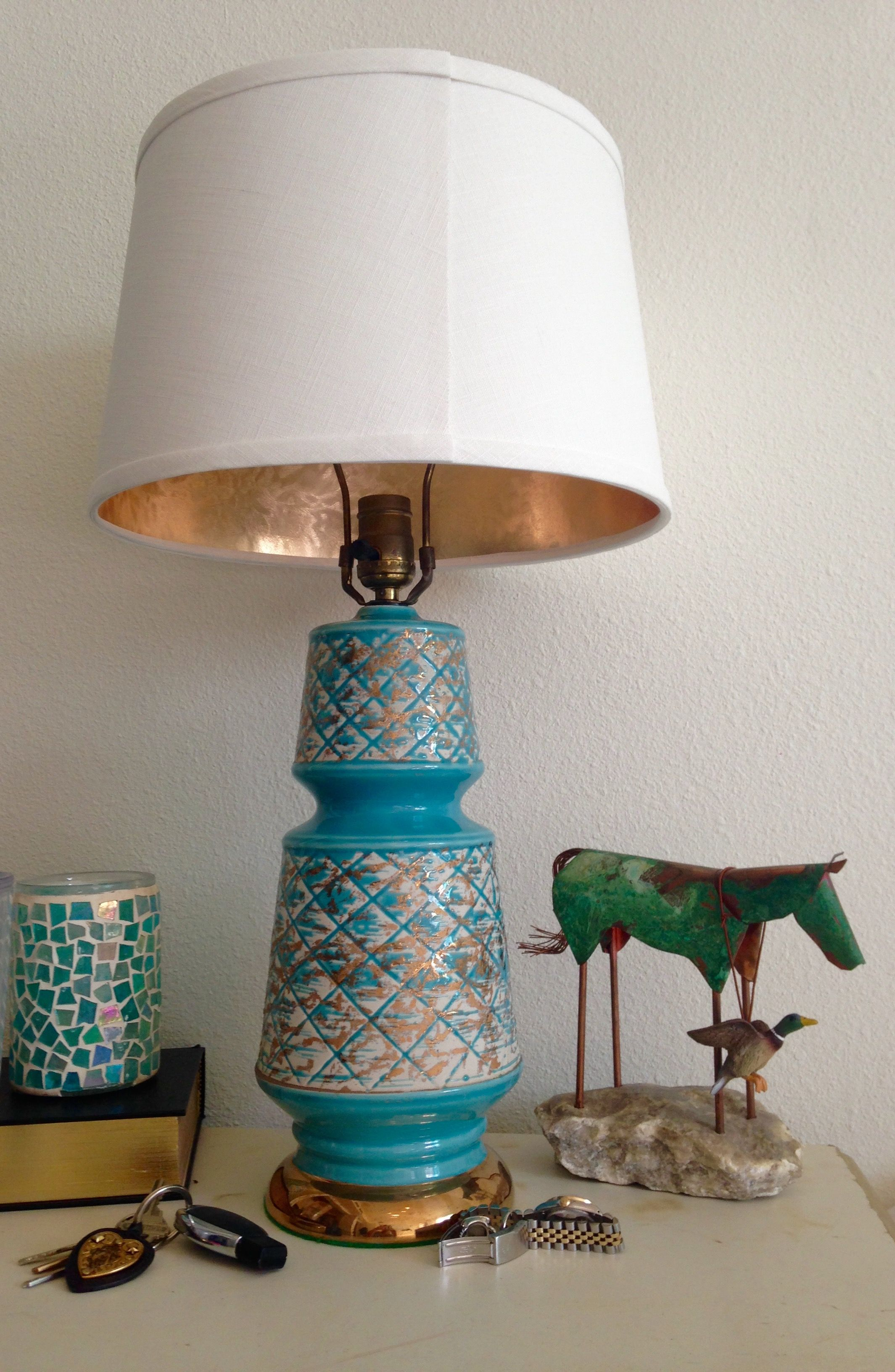 Redone antique brass lamps. New shades with gold lining.