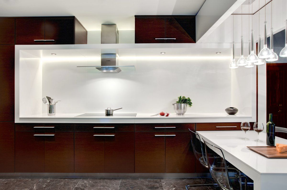 Sharp white brown kitchen design by den architecture for Brown kitchen designs