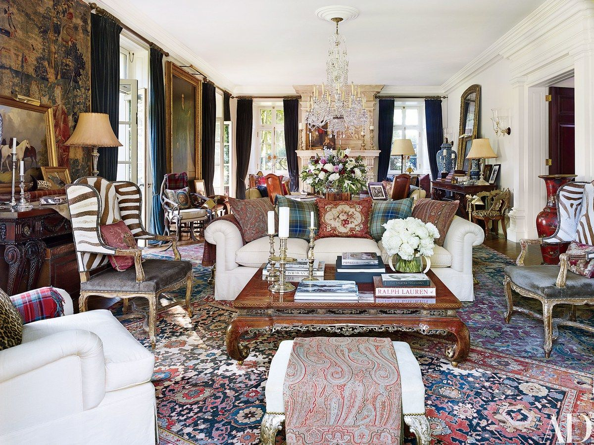 In the living room matching 19th century louis xv style wing chairs flank an 18th century chinese carved low table pillows made from antique textiles