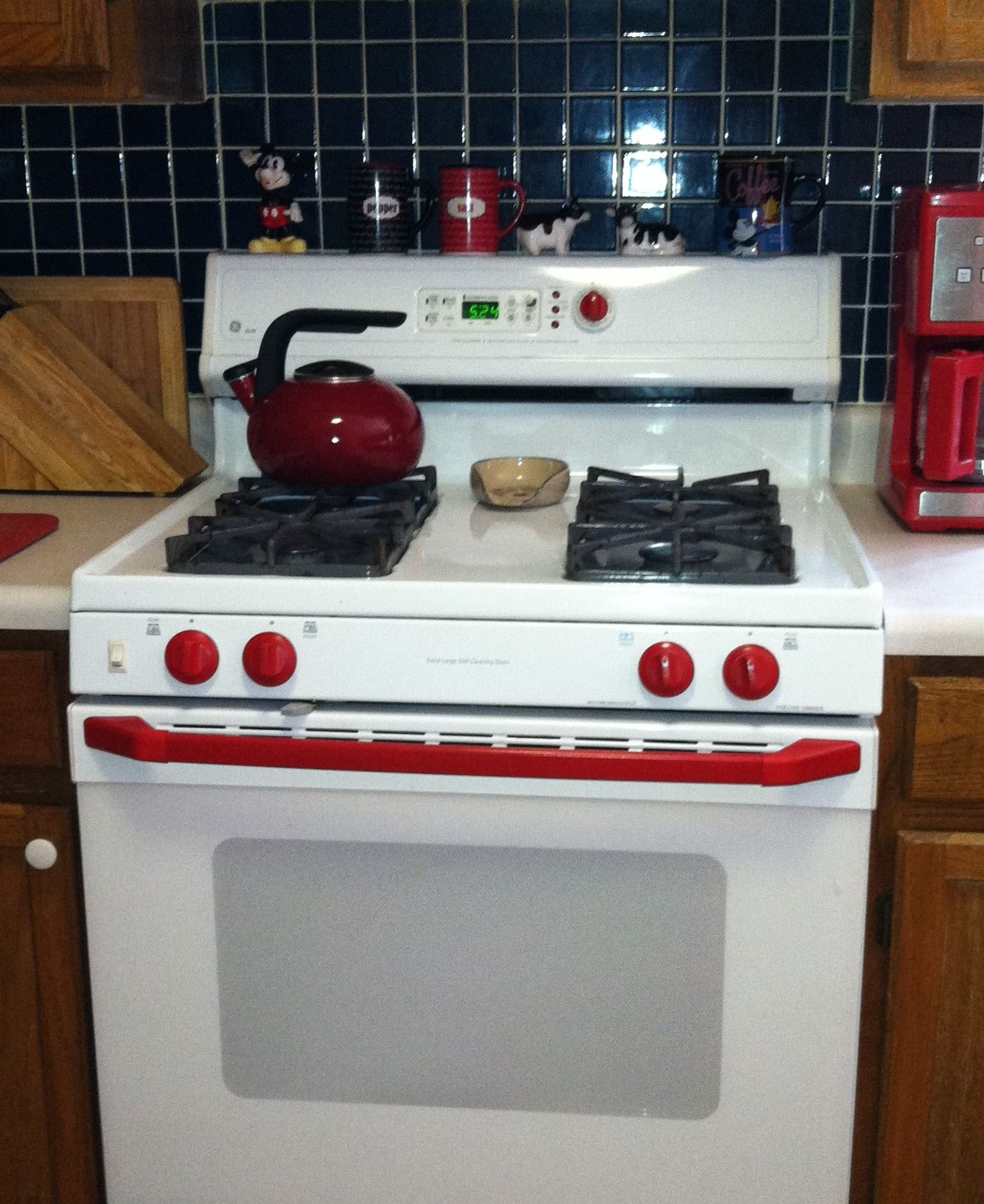 Used red spray paint to brighten up the knobs and handle on a white stove knobs removed easily removing the door handle to paint it required taking apart