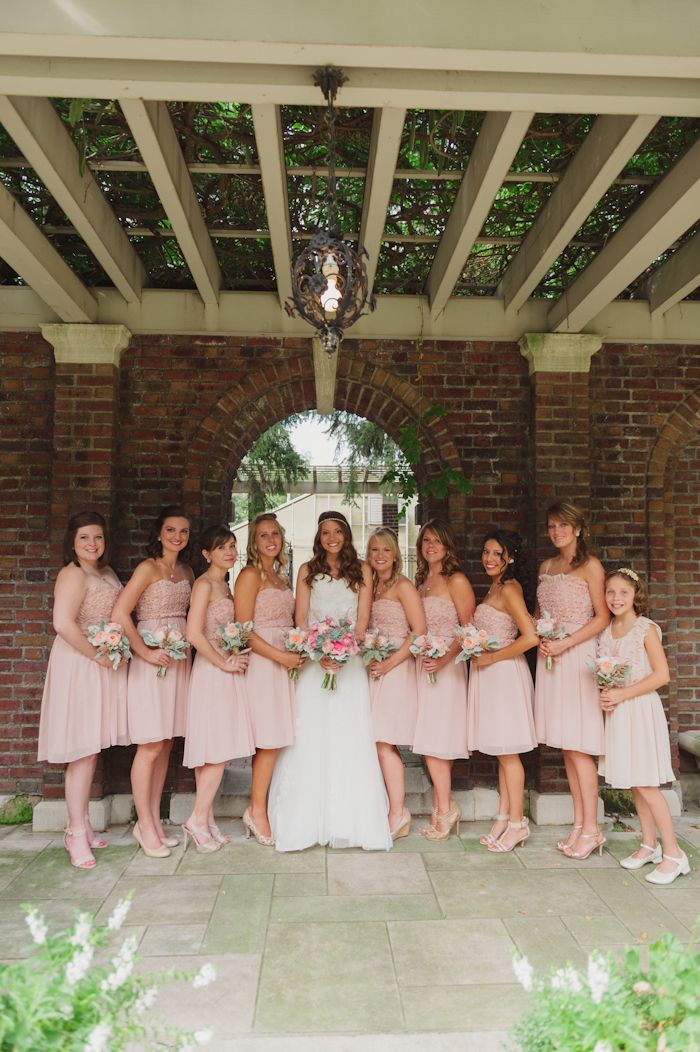 Blush bridesmaids dresses from Calvin Klein. / Image by Stacy Able Photography www.stacyable.com