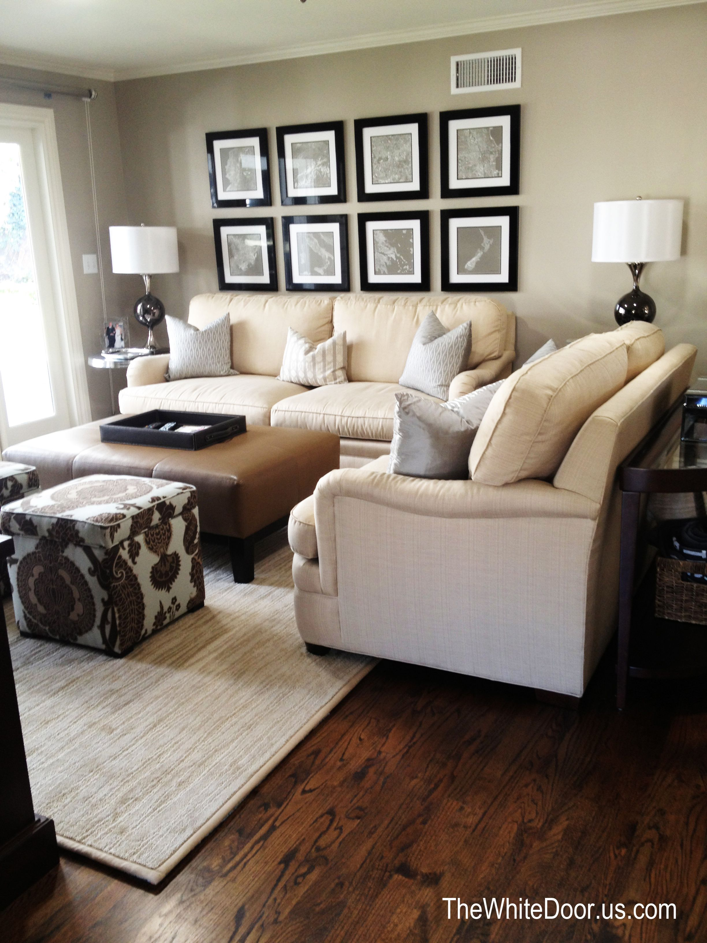 photos of living rooms with leather sofas room clocks next beige brown ottoman accent poufs pattern ideas
