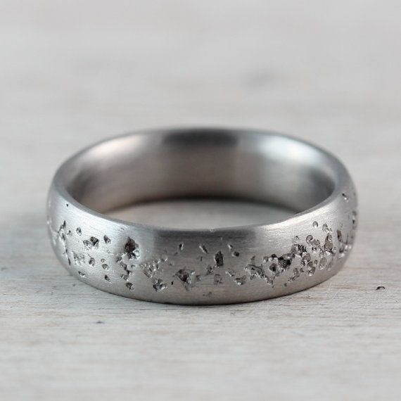 Concrete textured wedding band. This band has a deep rustic texture around the center, and a smooth rounded inside and edges. The interior has a rounded comfort fit, and the exterior has a subtle rounding. It is approximately 6mm wide and 1.7mm thick. Made of recycled palladium. Available with a matte or shiny finish. --{The Details}-- • One Ready to Ship 5mm wide concrete band • US ring size 5.5 • Matte finish • 950 Palladium Re-sizing before shipping is possible for many of the Ready to…