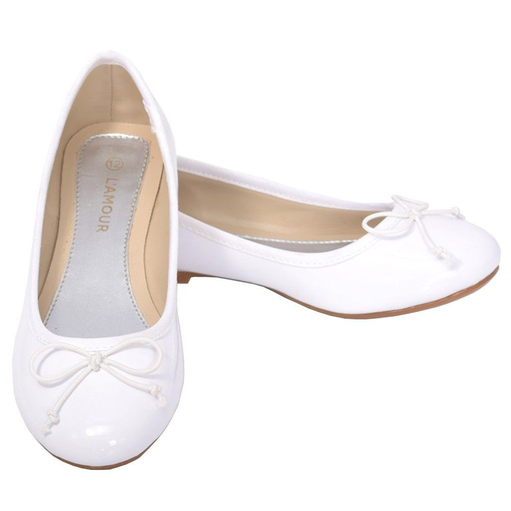 916d0adc961 A cute pair of dress shoes for your toddler girl from L Amour. These white  flat slip on shoes have a cute bow at the toe. Perfect with leggings