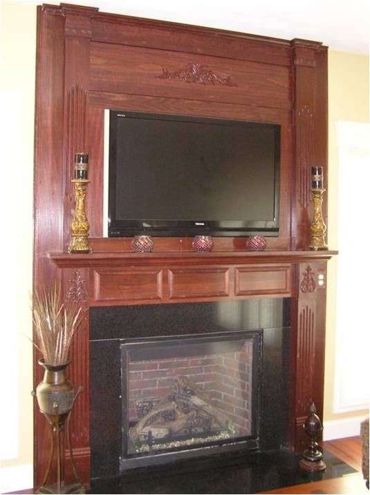 Poplar fireplace surround, custom built by Blume Construction trim carpenters