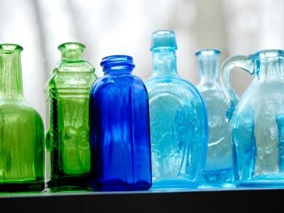 i've always loved different colored and shaped bottles. my kitchen window sill just might be waiting for this!