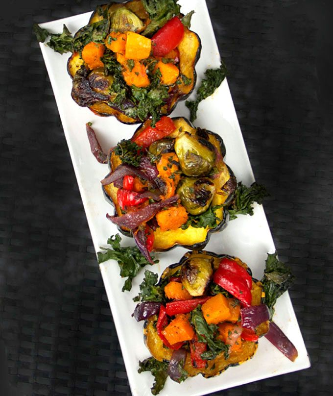 Roasted Squash Stuffed with Roasted Vegetables Roasted squash halves stuffed with a rainbow of roasted fall vegetables, drizzled with pomegranate molasses. A great side dish or veggie main dish recipe for Thanksgiving or any special occasion.