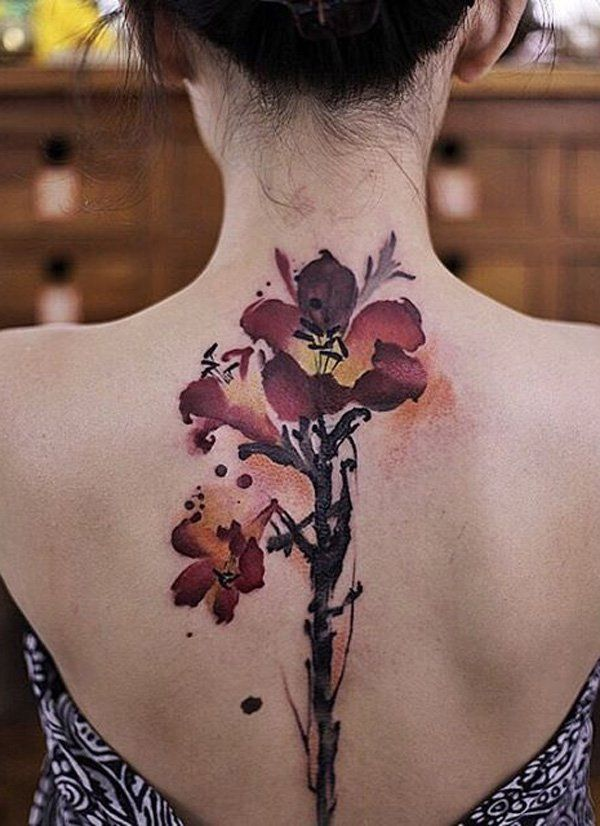 d6b35859aced9 This beautiful flower tattoo is perfect for spine tattoo. The flowers  themselves are placed in the upper back part so you can flaunt it easily  with some ...