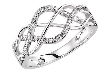 Gorgeous. 1/10 carat diamond 14K white gold ring...add a diamond in the middle?