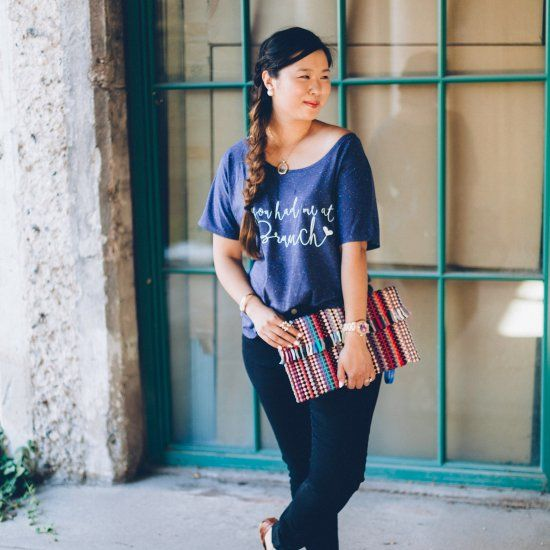 You had me at brunch. Pair a graphic tee and jeans with a colorful clutch for an everyday look.