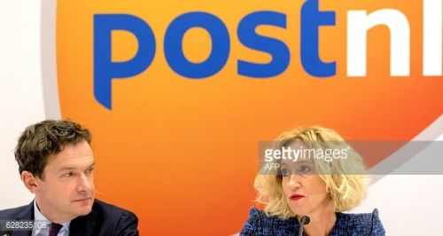 CFO Jan Bos (L) and CEO Herna Verhagen of PostNL give a press... #willemstadnl: CFO Jan Bos (L) and CEO Herna Verhagen of… #willemstadnl