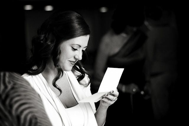 Abby reads a sweet note from Scott before their first look.
