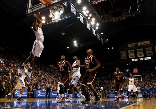 Andrew Wiggins 22 Of The Kansas Jayhawks Dunks Off An Alley Oop During The Game Against The Iona Gaels At Allen Fieldhouse Basketball Teams Alley Oop Jayhawks