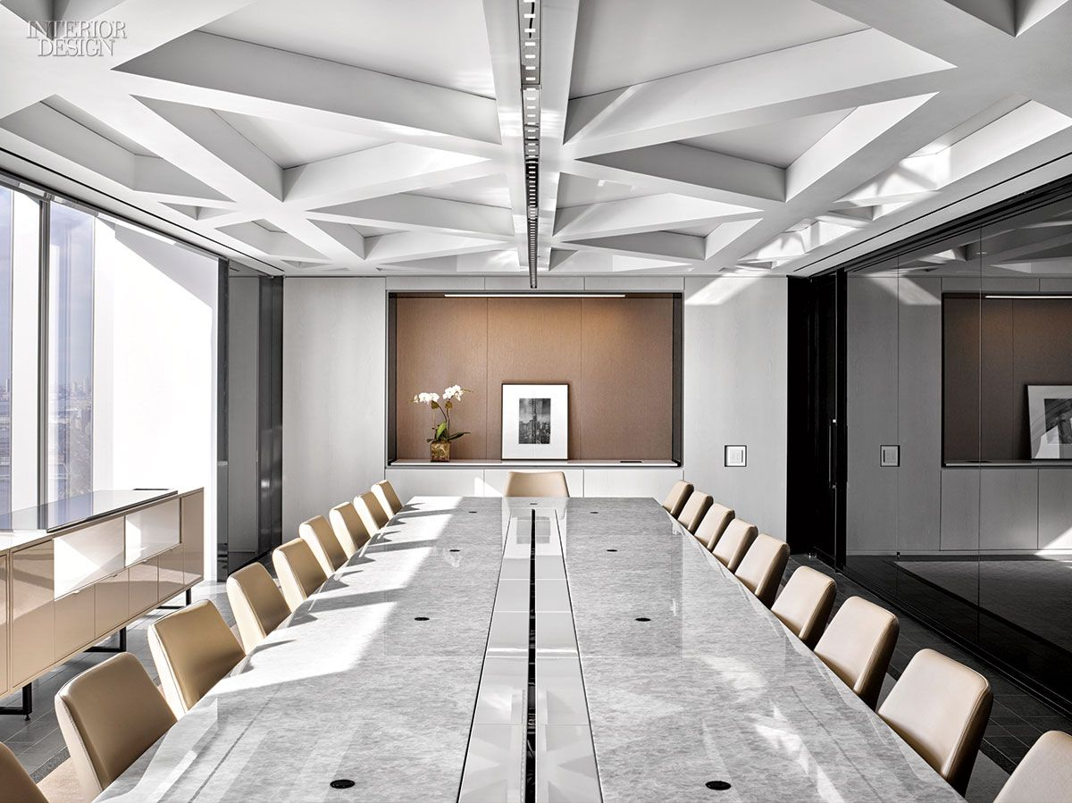 A Conference Room Boasts A Triangular Coffered Ceiling And A Custom Quartzite Topped Table Meeting Room Design Corporate Office Design Conference Room Design