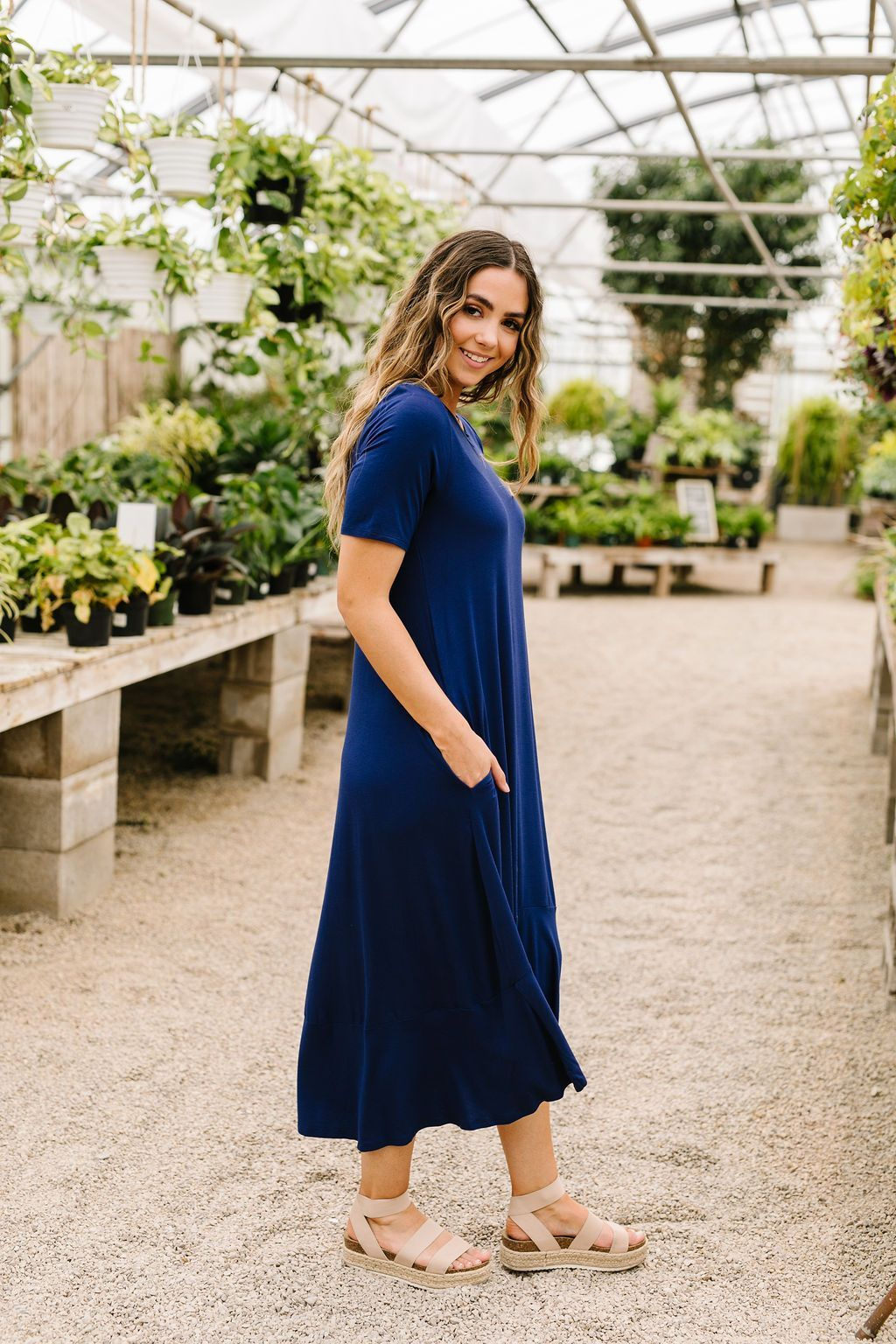 The loose flowing fit, high-low hem, and short sleeves mean this maxi dress is sure to be a summer hit! The rich navy color is a summertime classic. Add a cardigan or jacket and it will take you through the fall. LightweightStretchy Through MaterialSlightly SheerPocketsHigh-Low Hem 92% Rayon 8% Spandex Fits True To SizeMade In USA*Measurements listed below are of the actual clothing item* Small: Chest 36