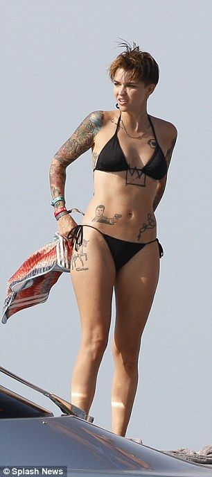 Oitnb star rubyrose shows off tats in ibiza as she for How to shower with a new tattoo