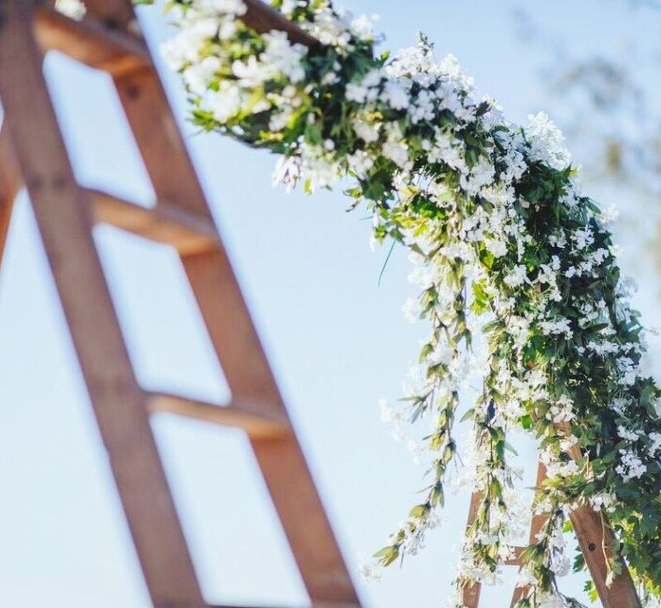 The Lakehouse Sunshine Coast.  Wooden ladder decorated with beautiful flowers on a stunning day for a wedding 🍃