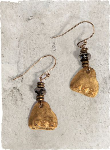Irregular disks of hammered 18 kt gold vermeil are topped with brass beads and faceted pyrite on the French wire earrings.