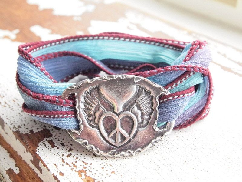 possible tattoo?   Sugarland - Peace Sign, Heart with Wings,Eco-friendly, Boho Chic, Silk Wrap Bracelet. $62.00, via Etsy.