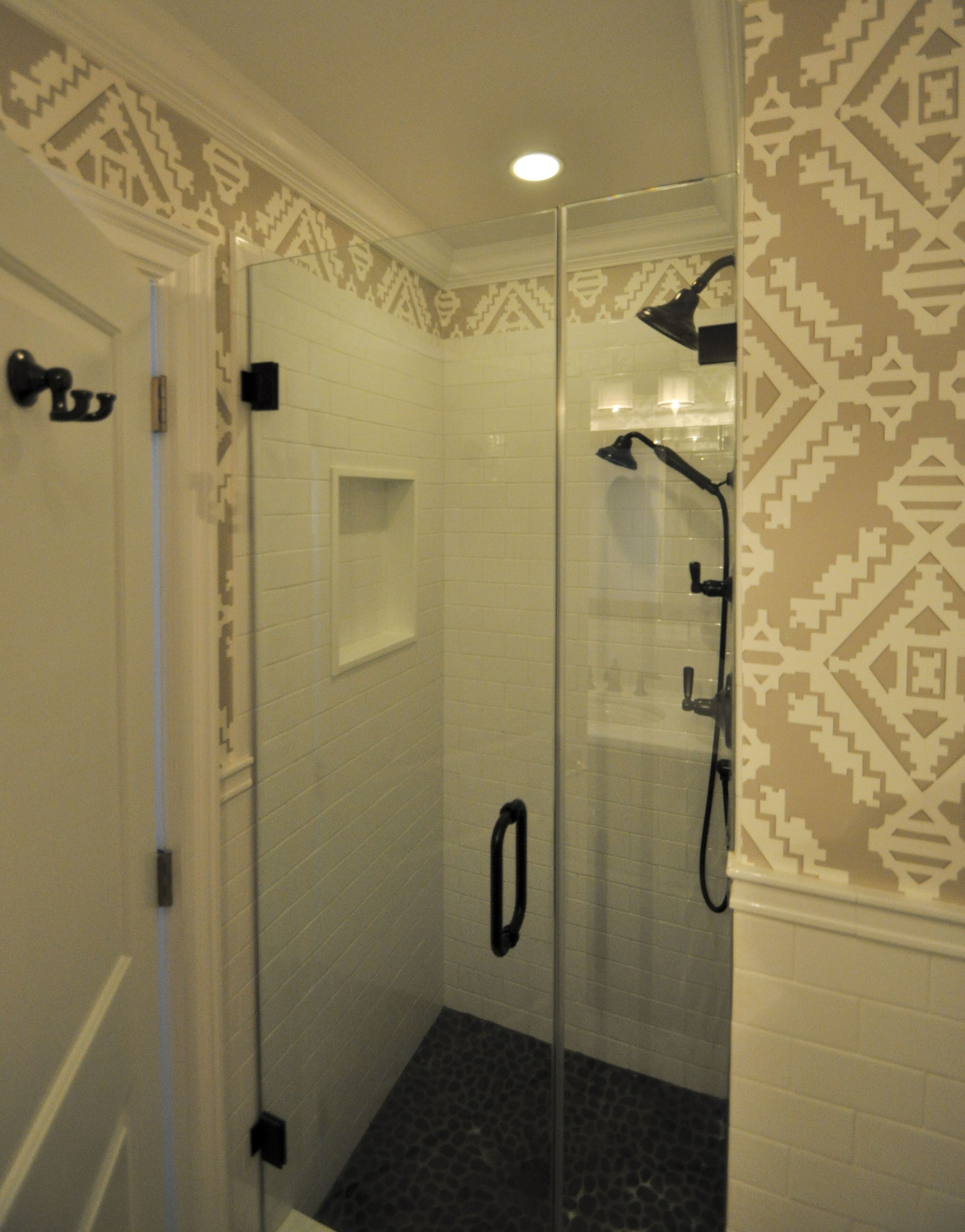 Stand up Shower for On-Suite Bathroom with Frameless Doors and Inset Niche.