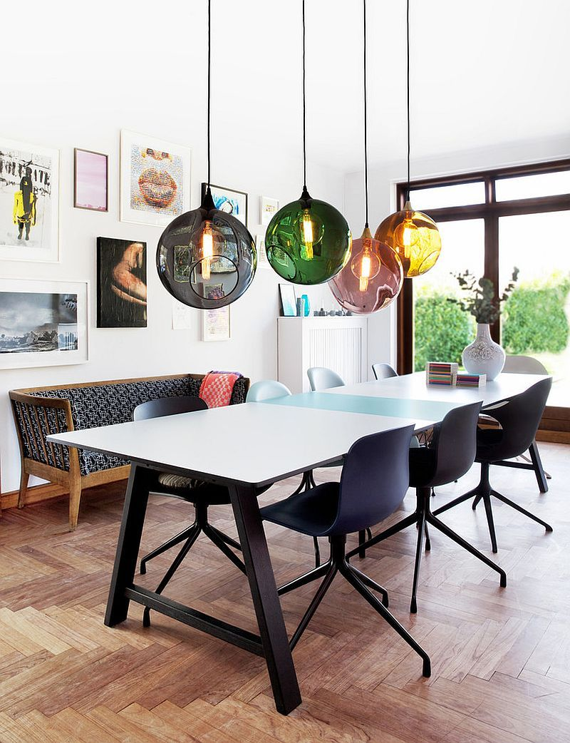 colorful orbs above the dining table breathe life into the curated contemporary dining room