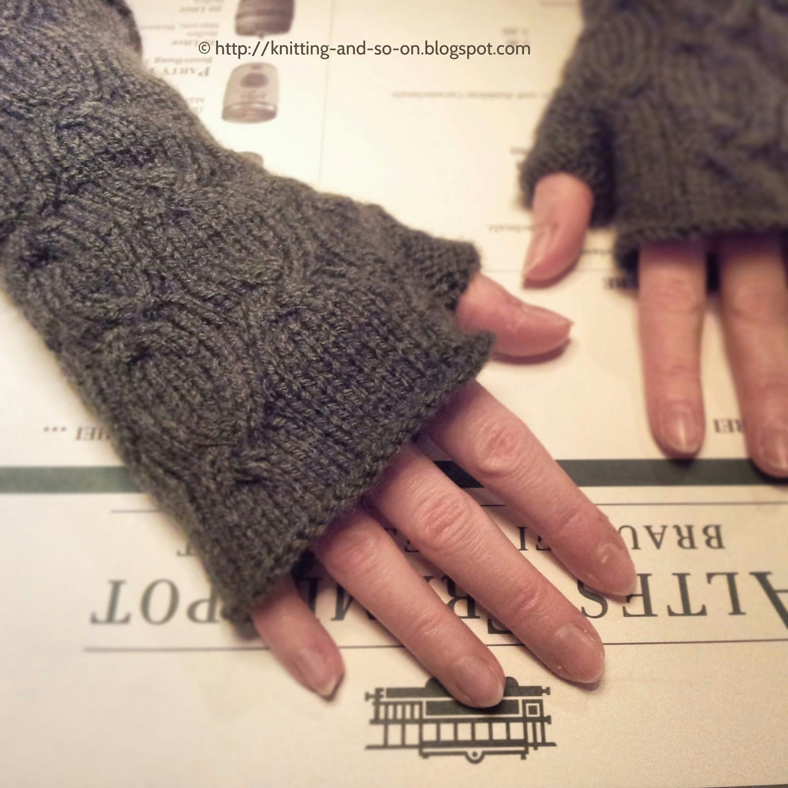 My first fingerless gloves with a cable pattern. I like the way the ...