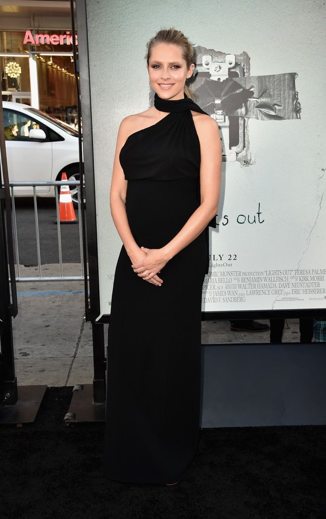 40d8e55ae386f Teresa Palmer Maternity Dress - Teresa Palmer oozed elegance in a black  halterneck maternity gown by Michael Kors at the premiere of 'Lights Out.'