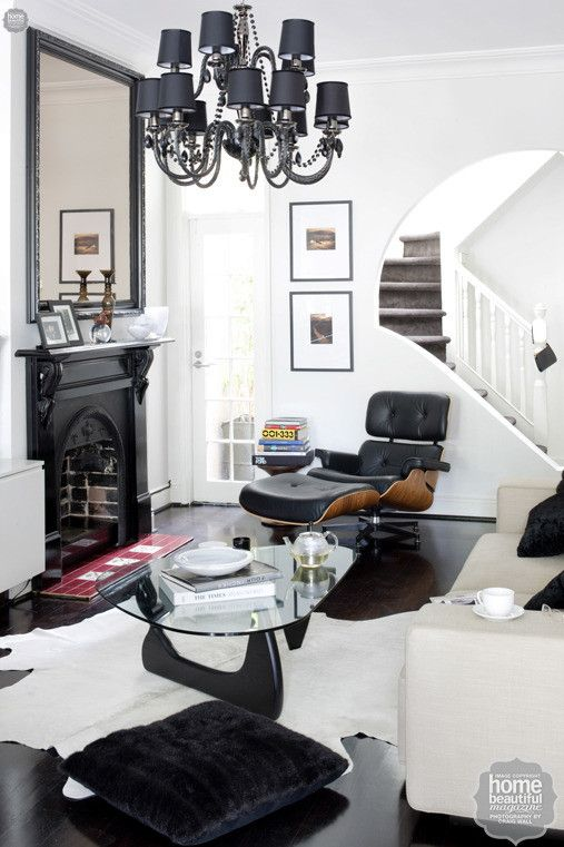 A glossy black fireplace and an oversized chandelier steal the show ...