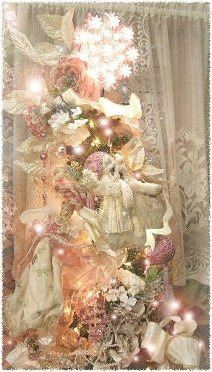 Stunning Pink Victorian Christmas tree with beautiful ornaments adorning this gorgeous Christmas tree.