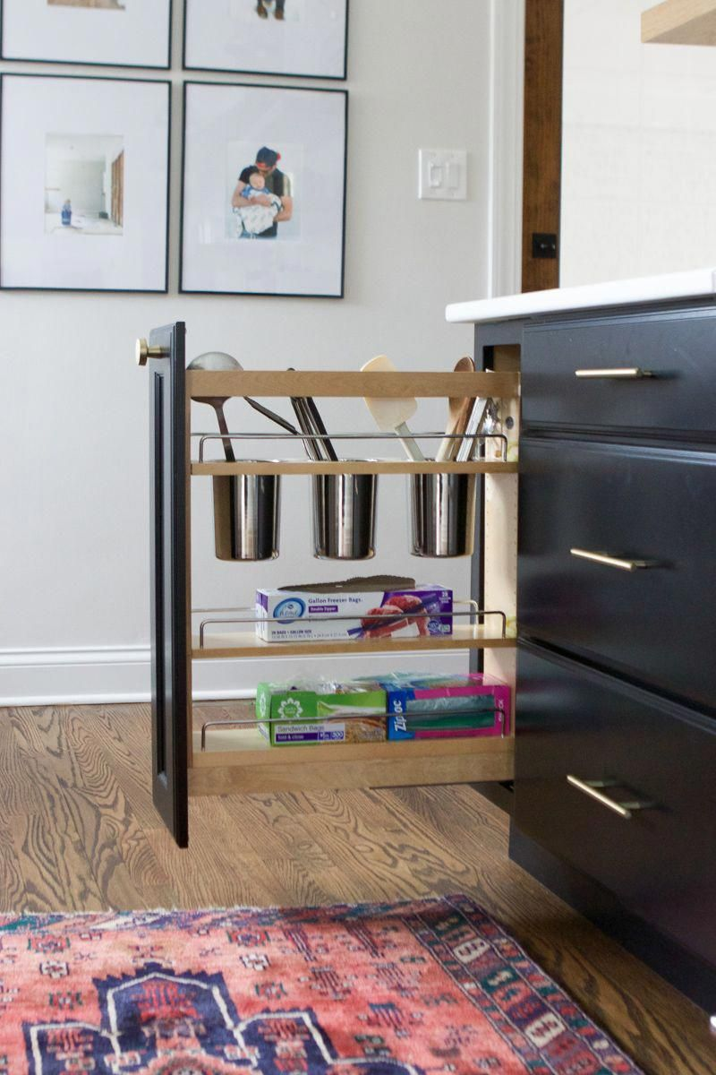 how to choose built-in kitchen cabinet organizers. Do you have plans to invest in built-in kitchen cabinet organization when it comes time to ordering new cabinets? If so, this post is for you. We talk about kitchen cabinet organization and the ways you can make sure everything is organized and easily accessible! #organized #organization #kitchen #kitchenstorage #kitchenorganizers #cabinetorganizers