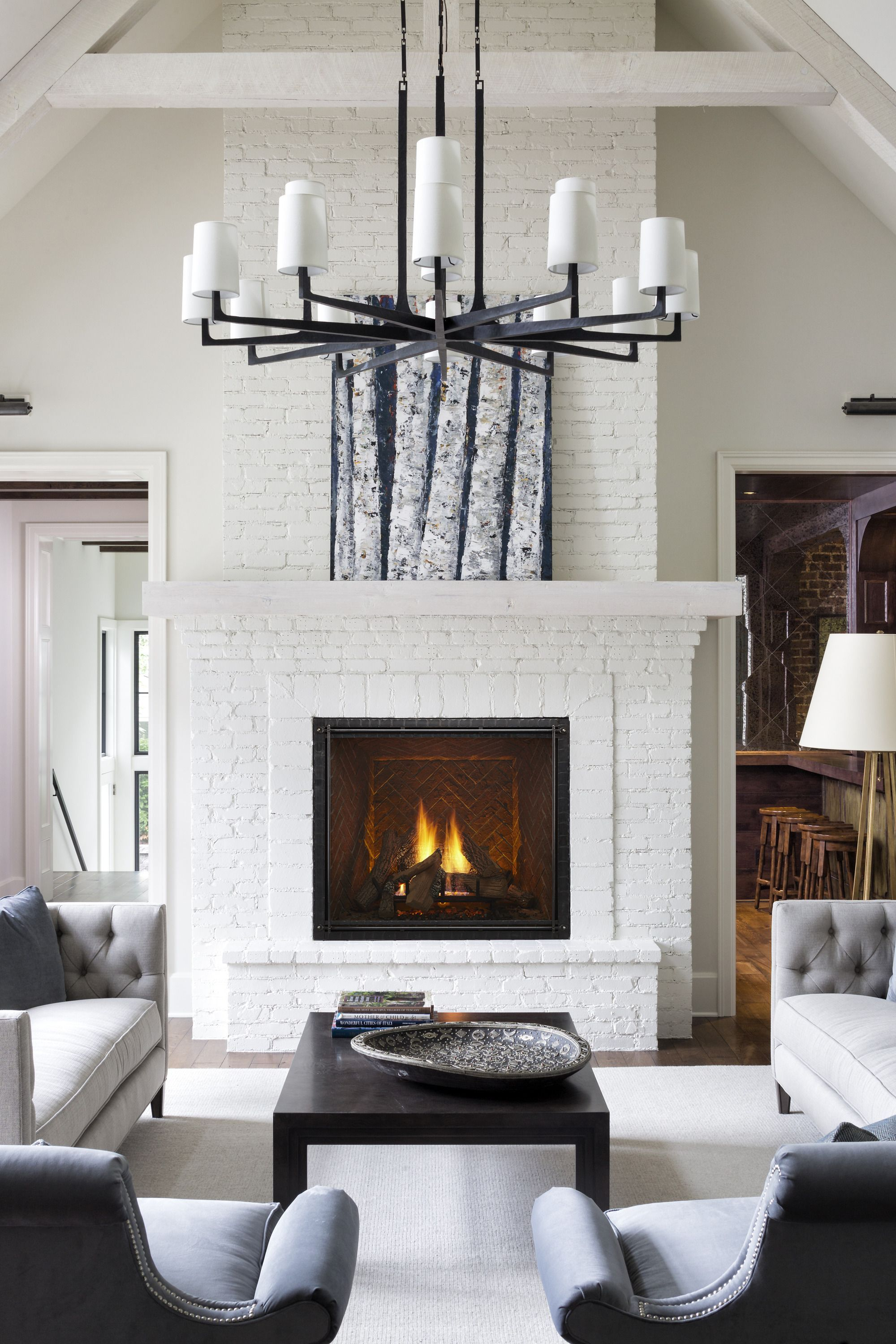 A Painted White Brick Fireplace Surround Makes For A Stunning