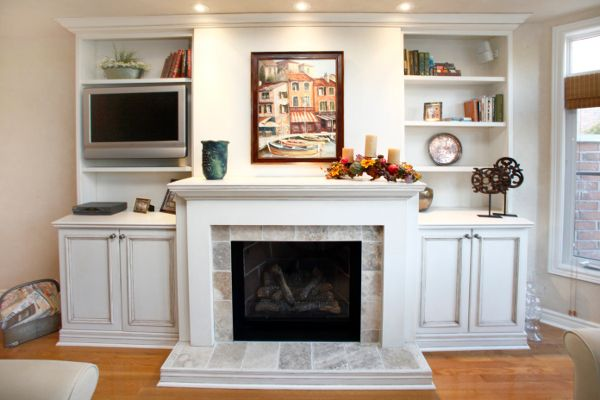 Built In Units Storage And Shelves Beside Fireplace Muskybay Millwork