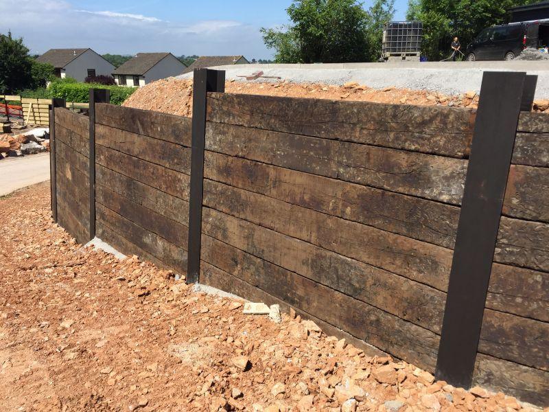 Wall Of Used Oak Railway Sleepers Slotted Into Rsjs Landscaping Retaining Walls Retaining Wall Railway Sleepers