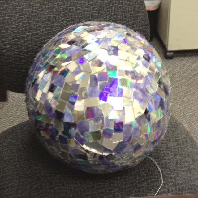 Did it myself-- a paper mache ball with cut up hot glued CD pieces.