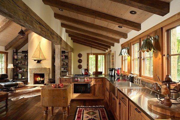 Rustikale Küche-Interieur Deckenbalken Holz-Schränke Edelstahl - arbeitsplatten küche holz