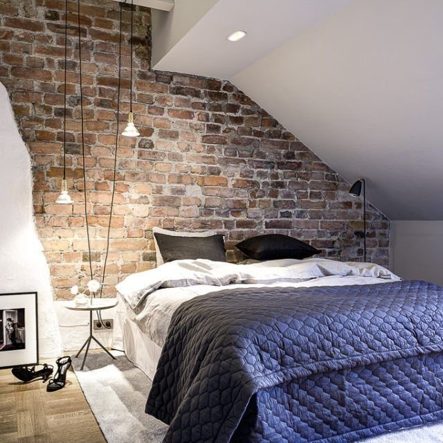 An Attic Bedroom With Exposed Brick Wall Yes Please
