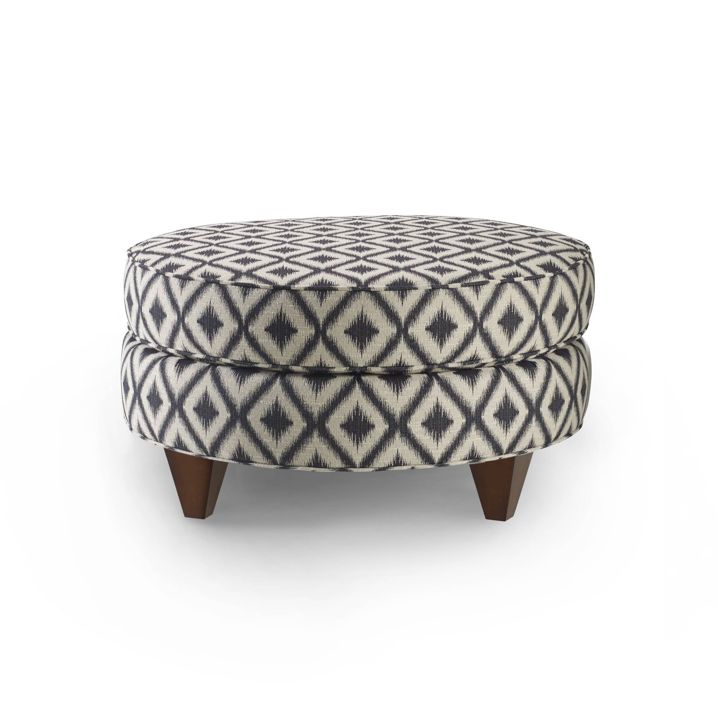 Add a pop of color to your bedroom with this on-trend Bax ottoman, featuring an espresso and cream upholstered top with comfortable foam filling. Designed with rich espresso wood legs, this on-trend ottoman is the ideal place to rest your feet.  416