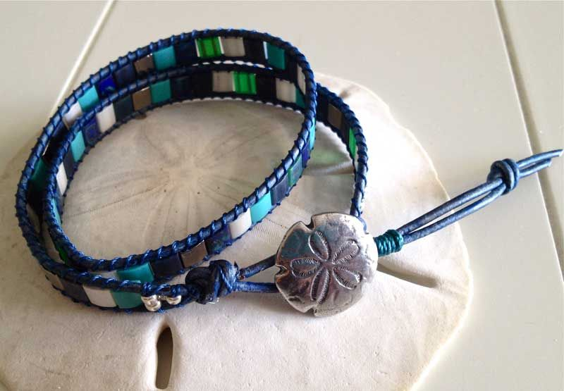 One of my favorites I have made of the Tila bead bracelets. The sand dollar button seems to fit really well the colors of the beads I chose. Love the distressed royal blue/navy leather as well…reminds me of the well worn stones and shells found along a shoreline...