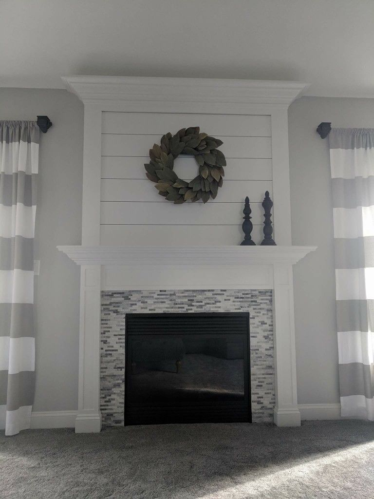 Tall shiplap fireplace log burner fireplace wintertile over brick