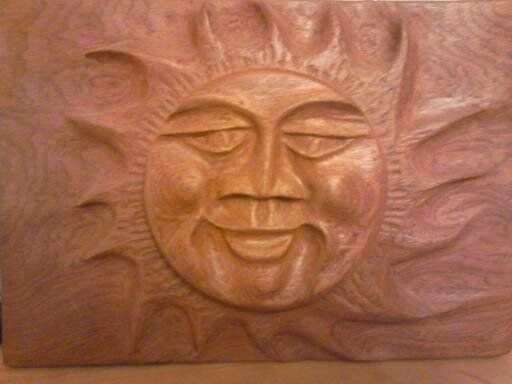 a smiley sun ,to brighten your day.carved from 2 pieces of mahogony