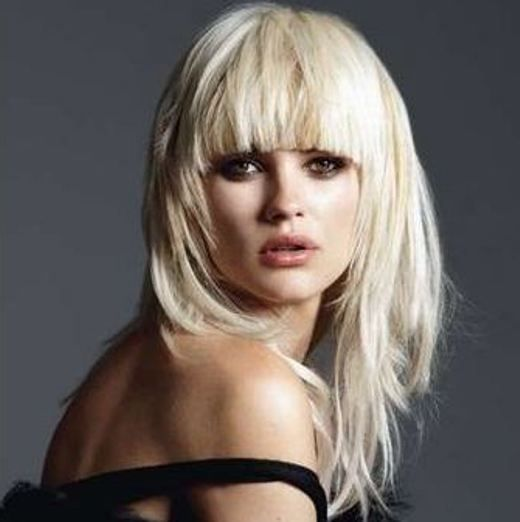 blond long layered hairstyle with bangs