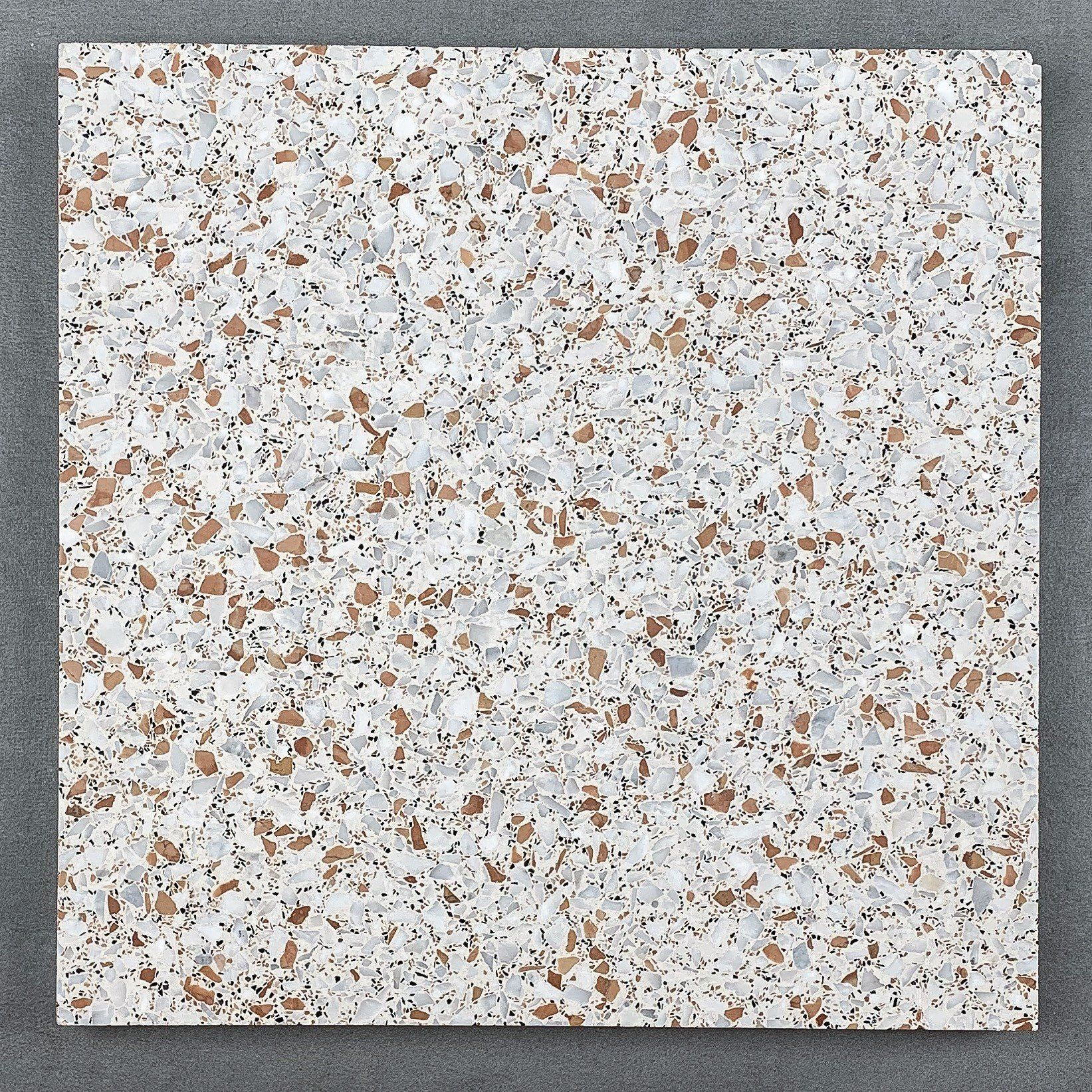 A Cream Based Terrazzo Tiles Of Grey White And Red Coloured