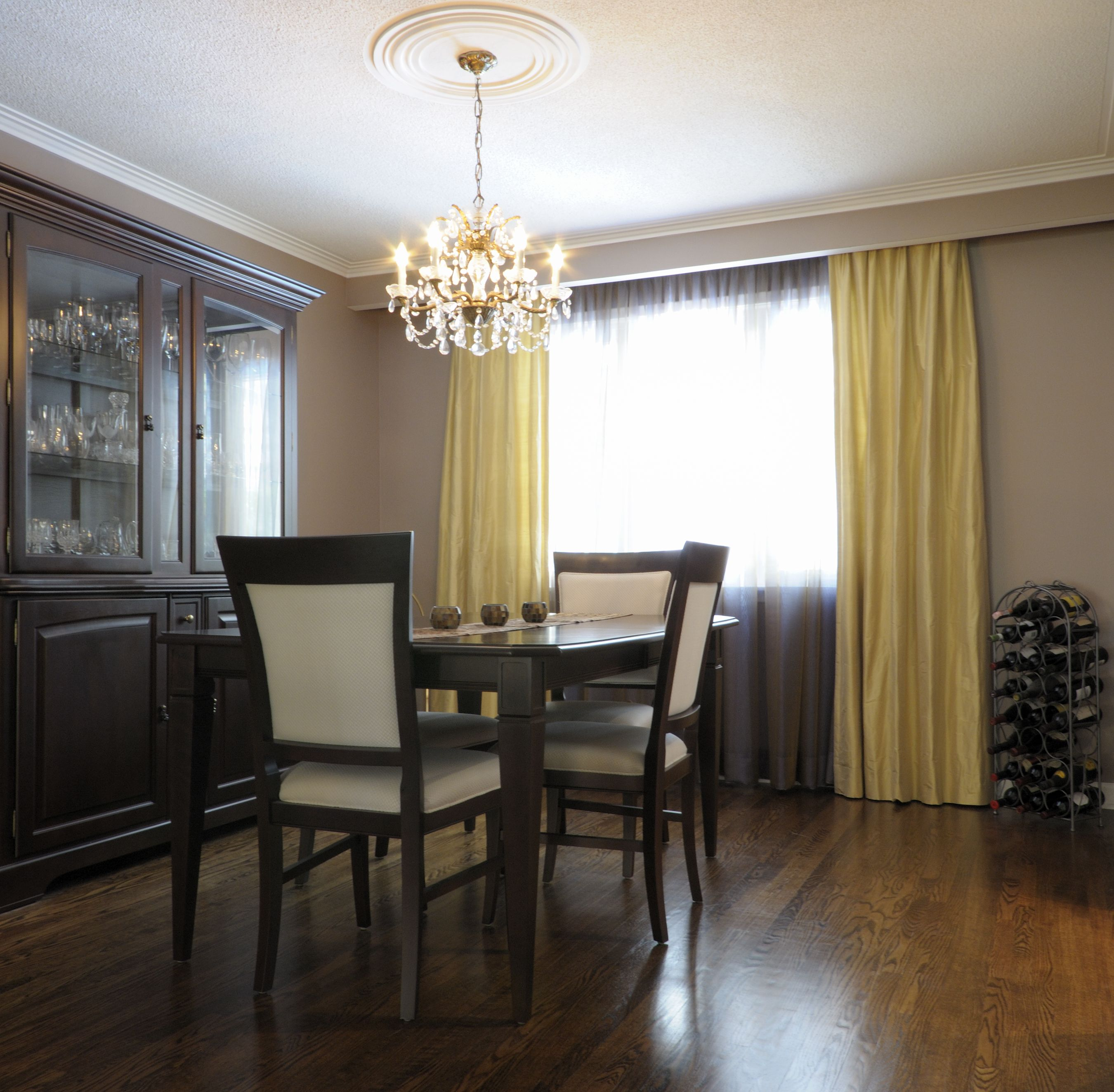 A transitional dining room using bright corn silk colored