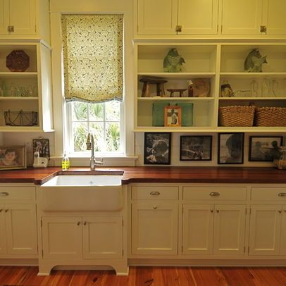 Like the wood countertop, could pick up a cheap on from Home Emporium and put an epoxy coating on it.